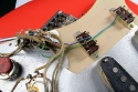 Fender_strat_1961_coral_extra_switches_3