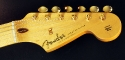 Fender_strat_gold_LTD_1989_cons_head_front_1