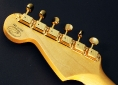 Fender_strat_gold_LTD_1989_cons_head_rear_1