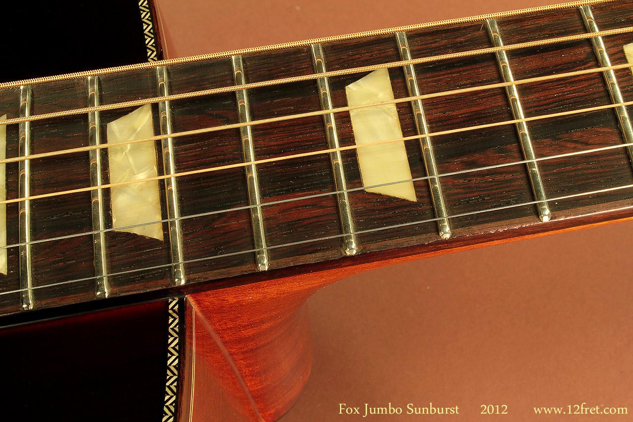 Fox-Jumbo-Sunburst-2012-fingerboard-binding-1