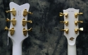 Two_White_Guitars_Heads_back